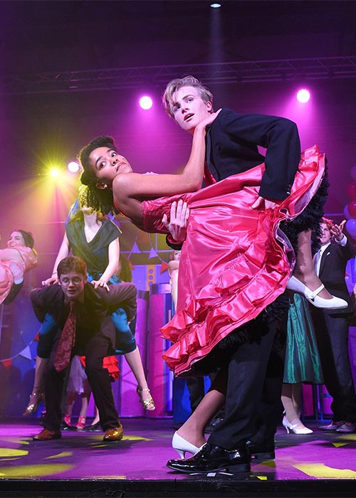 Stunning costumes for Grease the musical prom scene