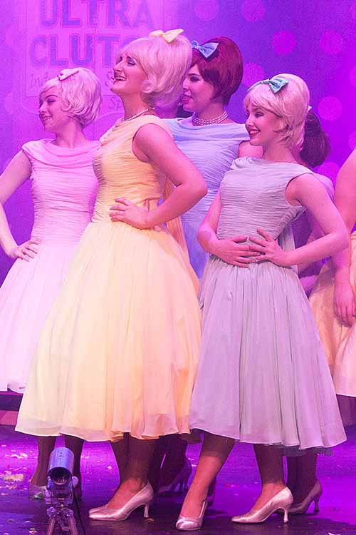 Councilettes in Hairspray wearing pastel coloured 1950s style chiffon dresses