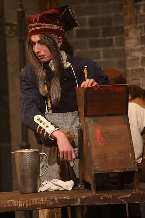 Monsieur Thernardier With Meat Grinder In Hat And Apron