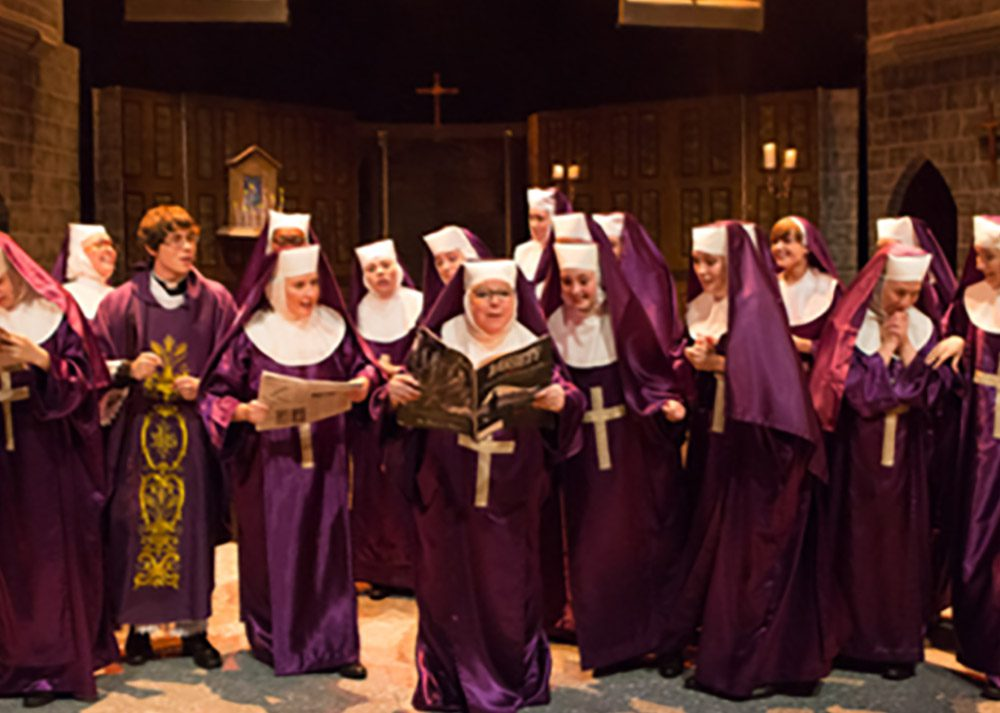 Purple Nuns costumes with white wimple's, vails, shoes and crosses for Sister Act the Musical.