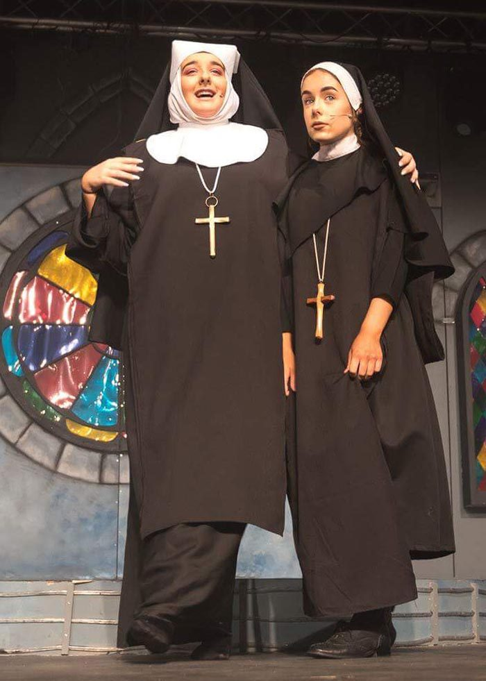 Thespis supply complete set of Black Nuns costumes with white wimple's, vails, shoes and crosses for Sister Act the Musical.