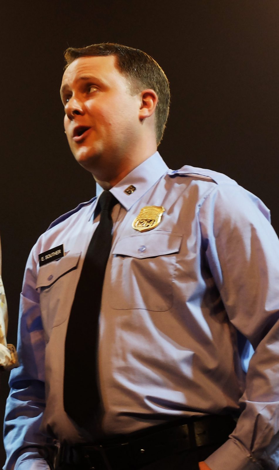 Sister Act - Eddie Souther costume consiting og blue police shirt tie gold police badge.